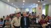 El secretario general provincial de AUGC Murcia (izqda.), Juan García Montalbán, y el secretario general de AUGC, Alberto Moya, en primer término, posan ante los  asistentes a la Asamblea General Ordinaria de AUGC Murcia.